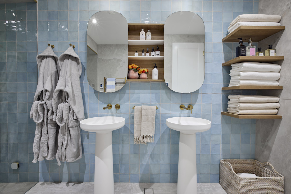 Twin pill mirrors and freestanding basins in downstairs steam room
