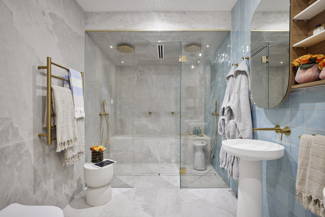 Basement steam room with grey built-in seat