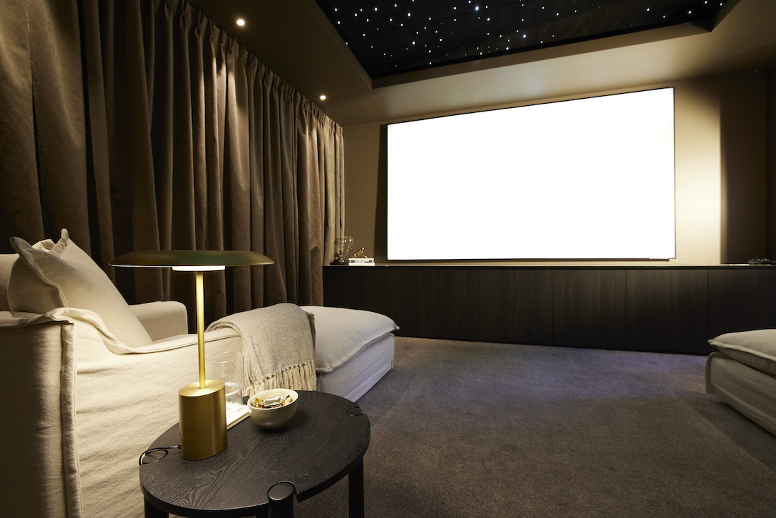 At home cinema set up in basement with large projector screen