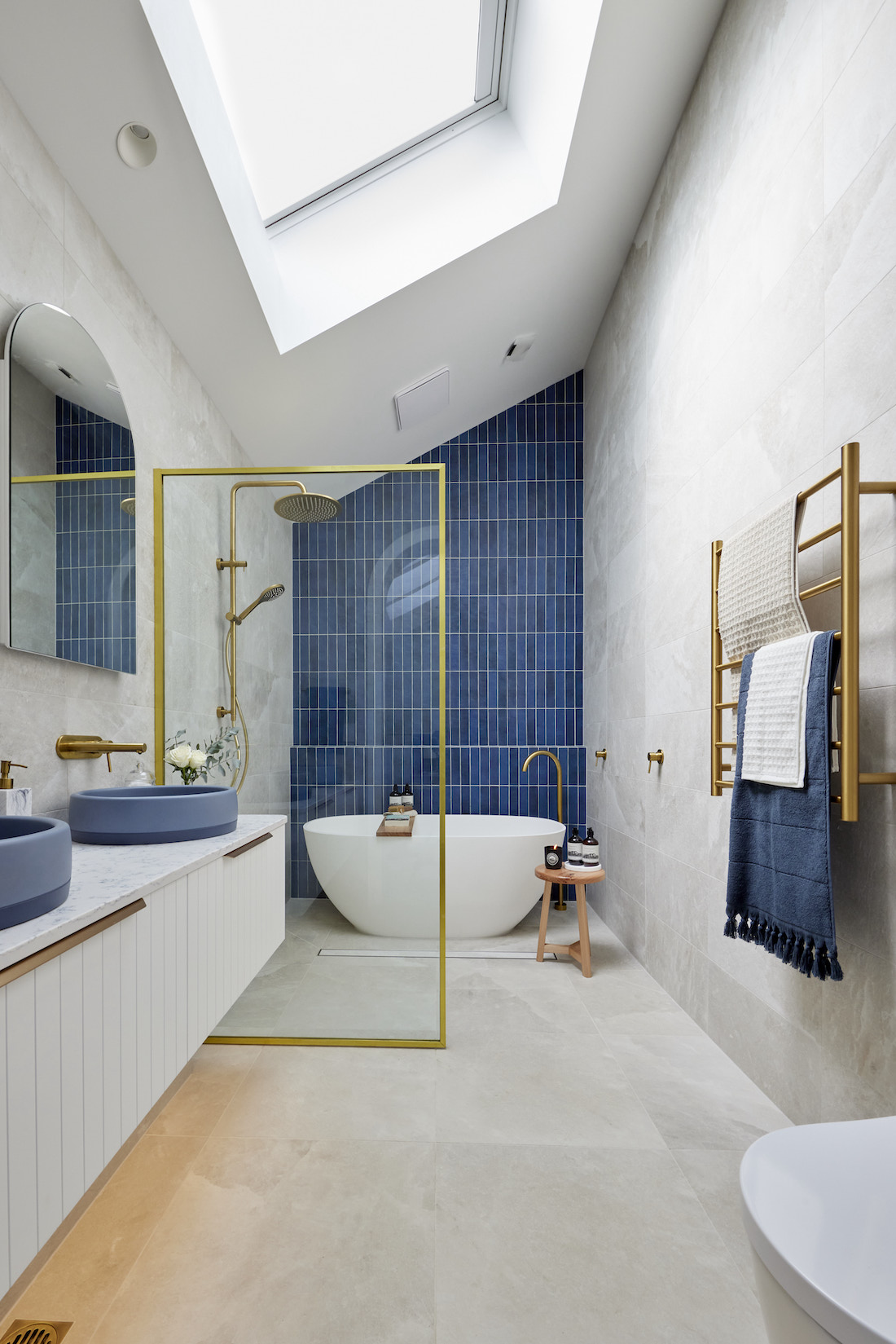 Blue bathroom wall with gold feature accents