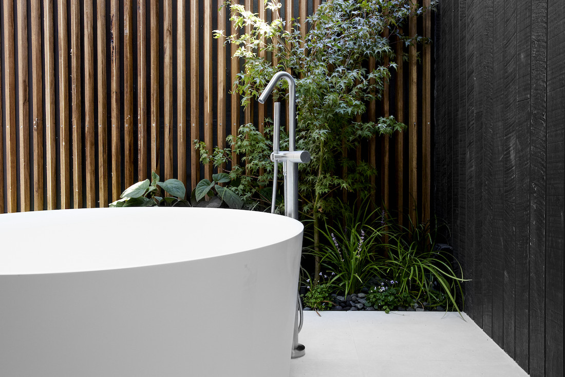Outdoor bath with landscaped gardens