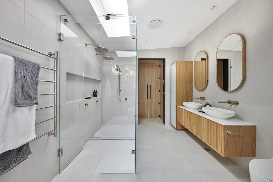 Double shower in grey and timber bathroom