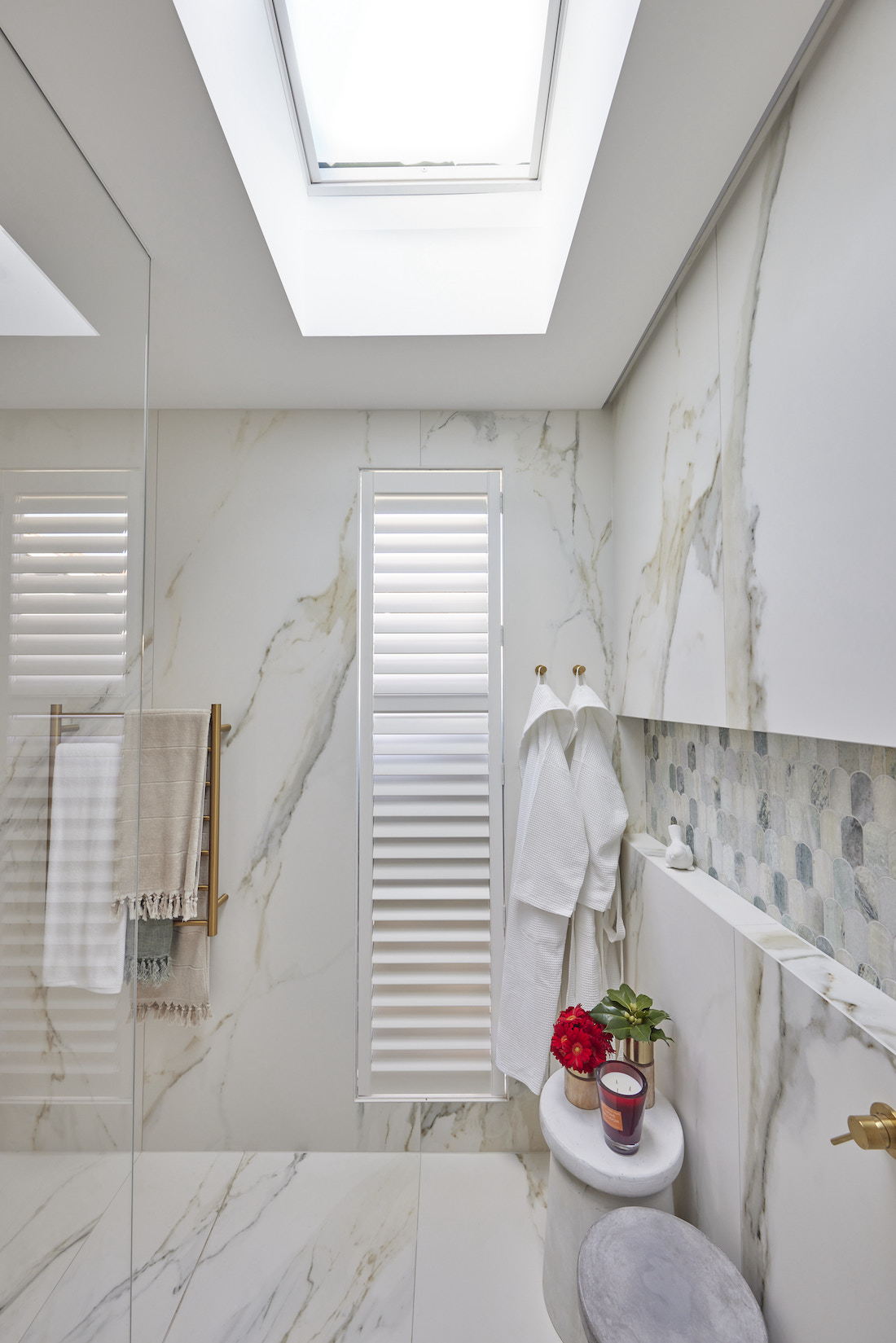 Shutters in marble bathroom