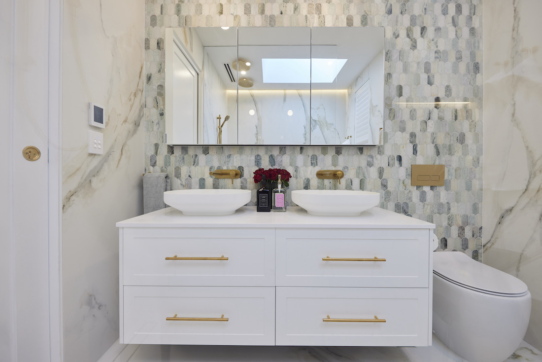White vanity with green paddle pop tile