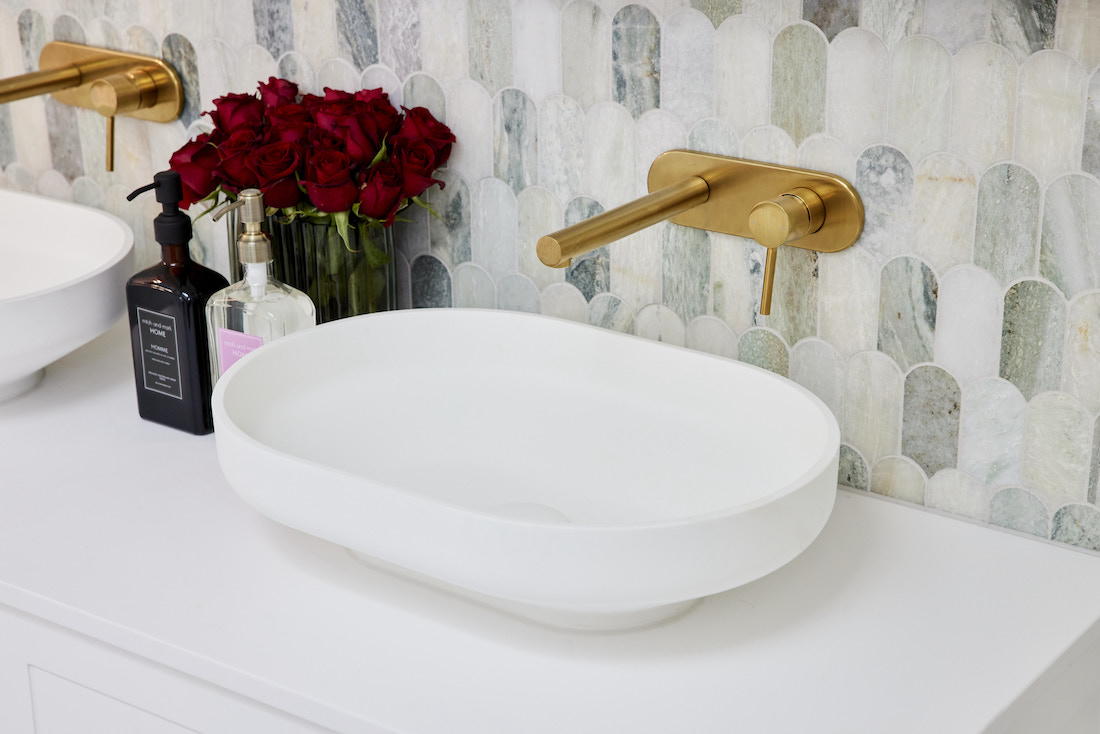 Brushed gold tapware with oval basin