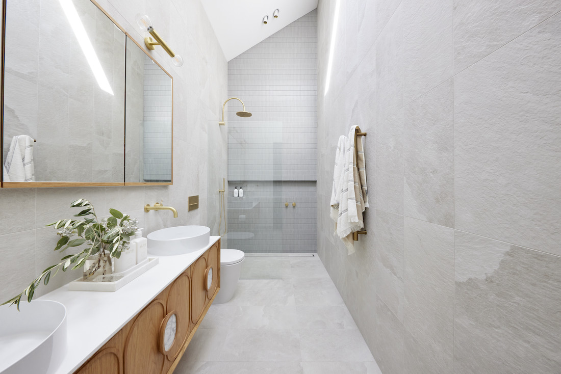 Grey and timber ensuite with gold accents