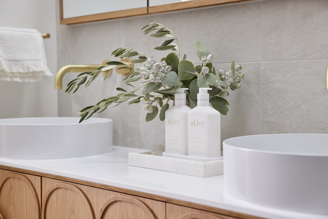 White Nood sinks with white bathroom accessories