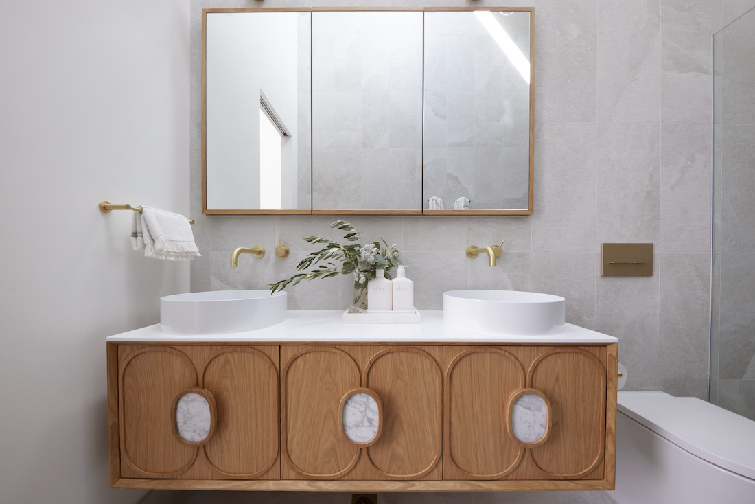 Petal panelled bathroom cabinet with marble insets