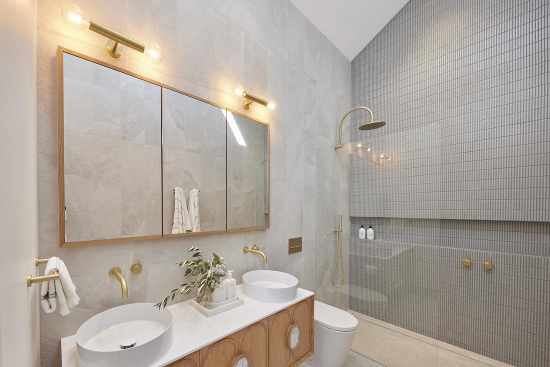 Frameless glass shower with kitkat tiles