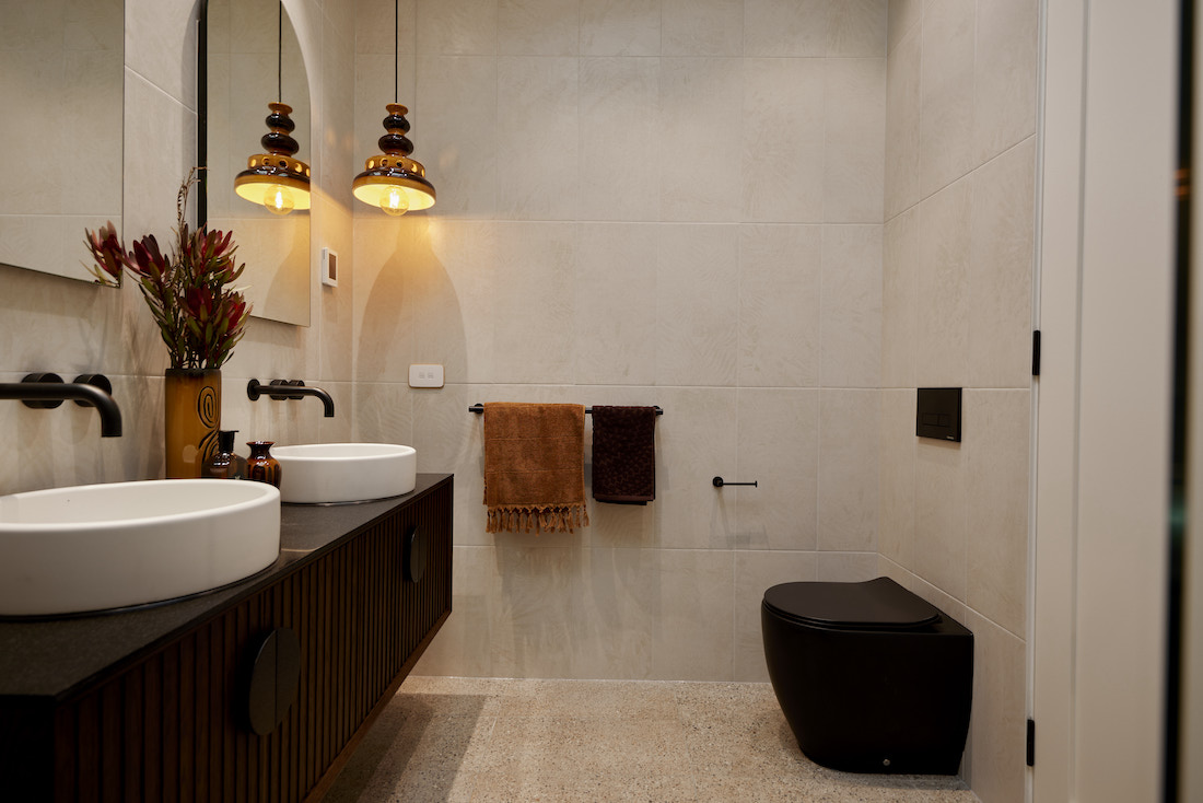 Modern retro bathroom with black toilet