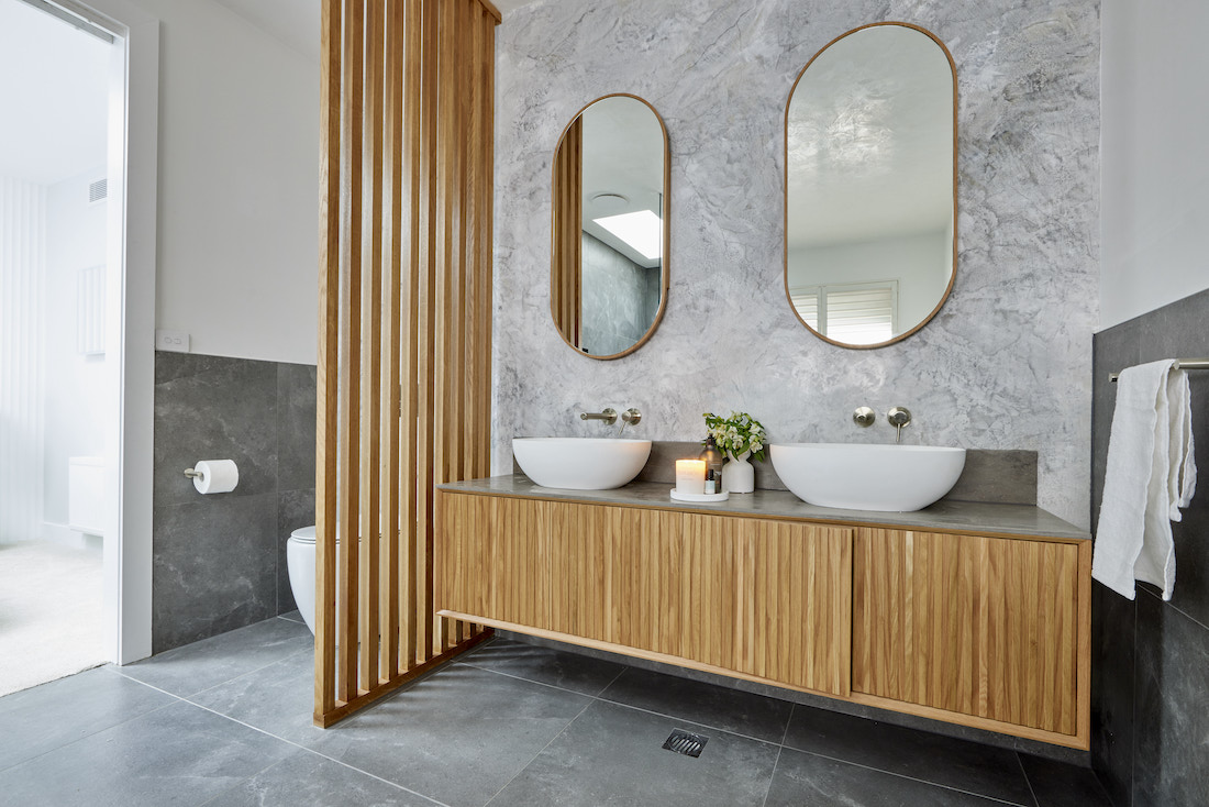 Timber panelled toilet wall in bathroom