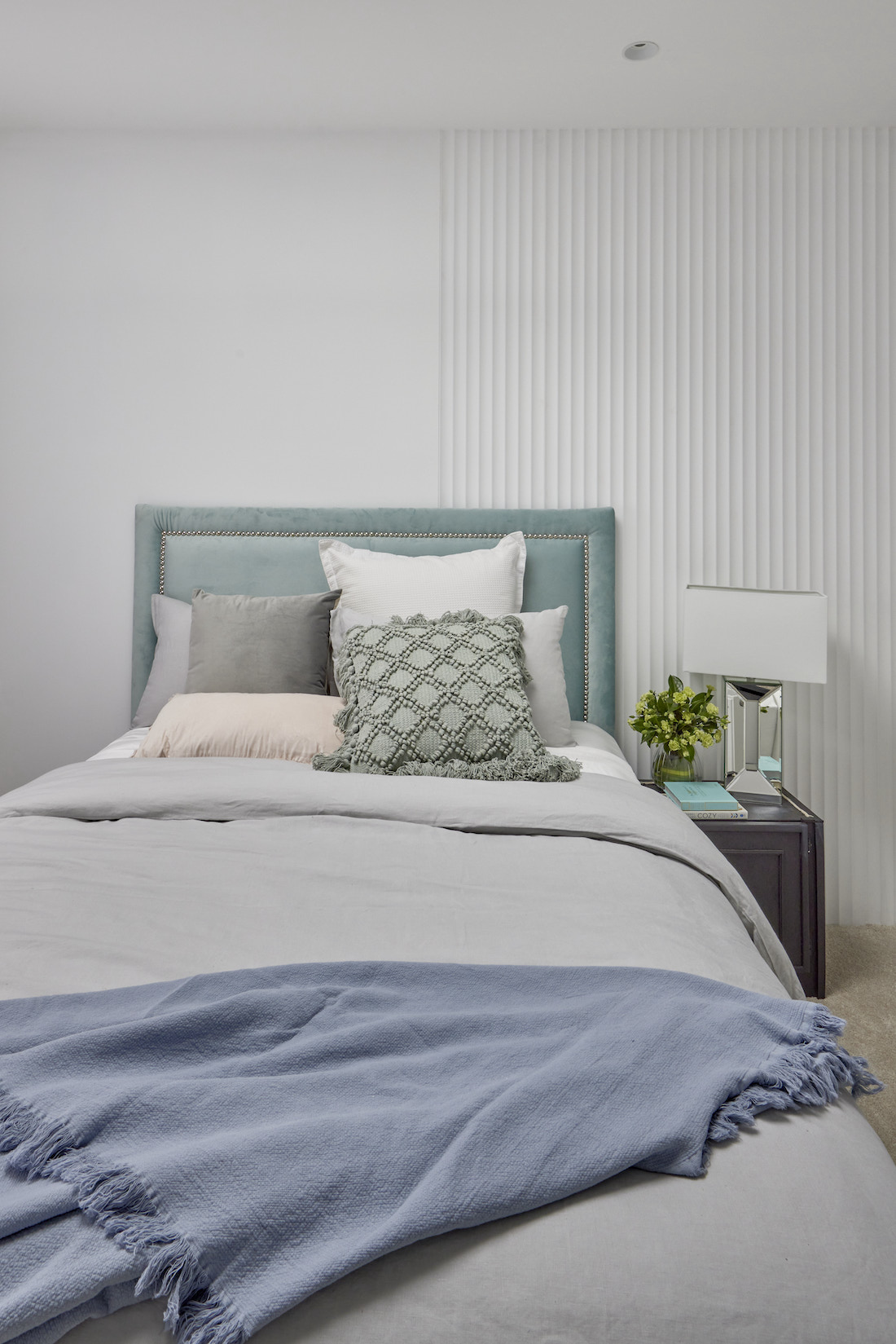 Fabric bedhead with half scalloped wall