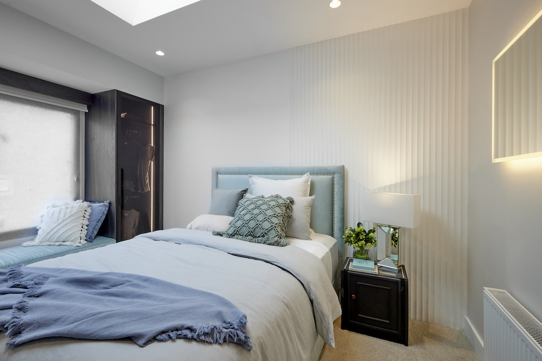 Bedroom with half scalloped wall