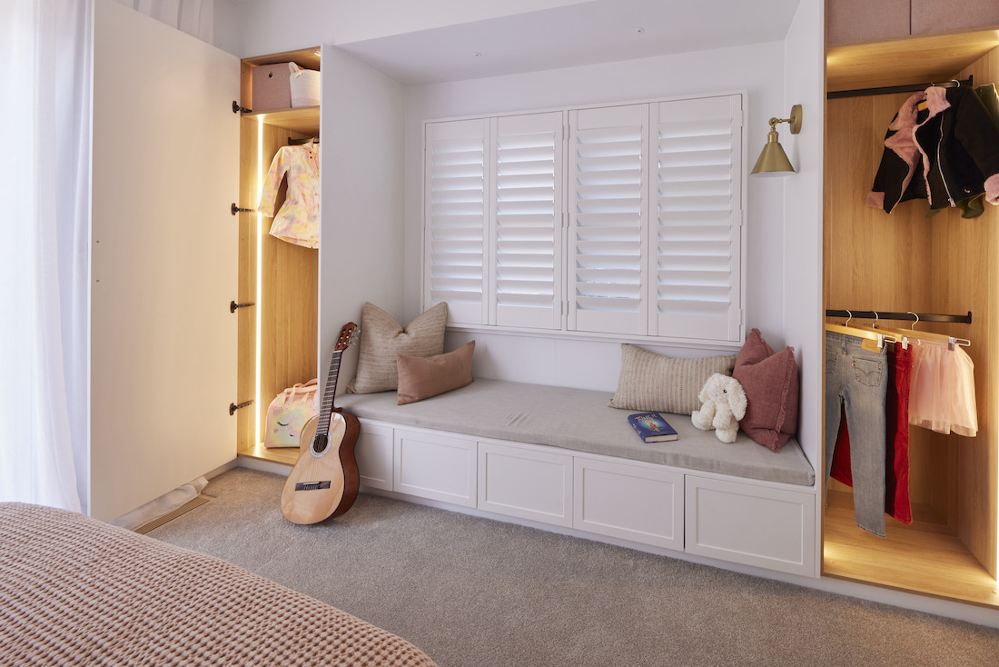 Built in window seat with wardrobes either side