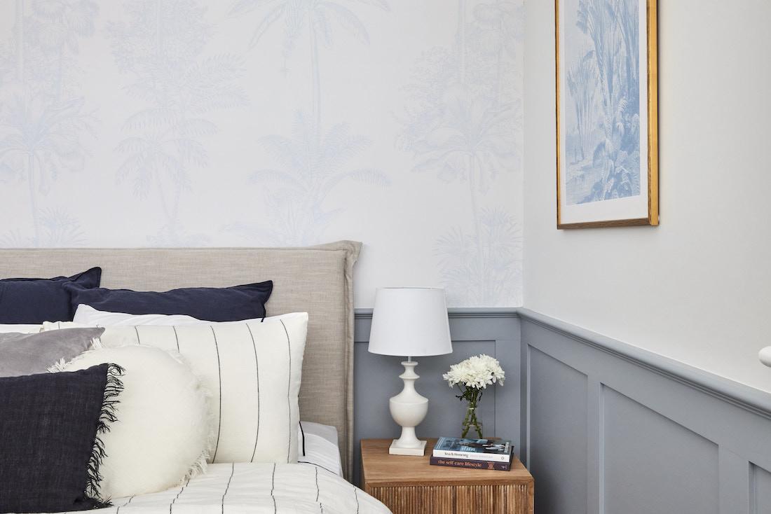 Blue wainscot trim on wall