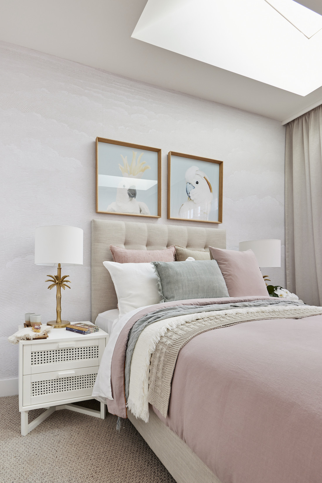 Guest bedroom in blush and sage tones