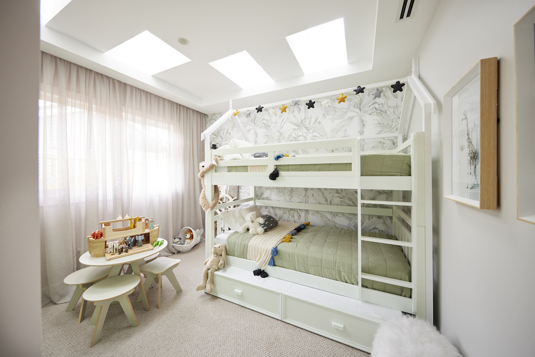 Kids bedroom with skylights and bunk beds