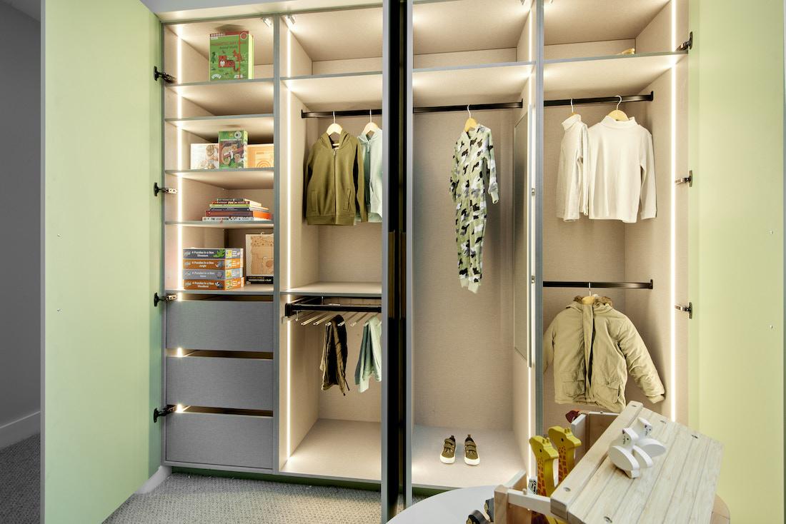 Inside kids wardrobe with green doors