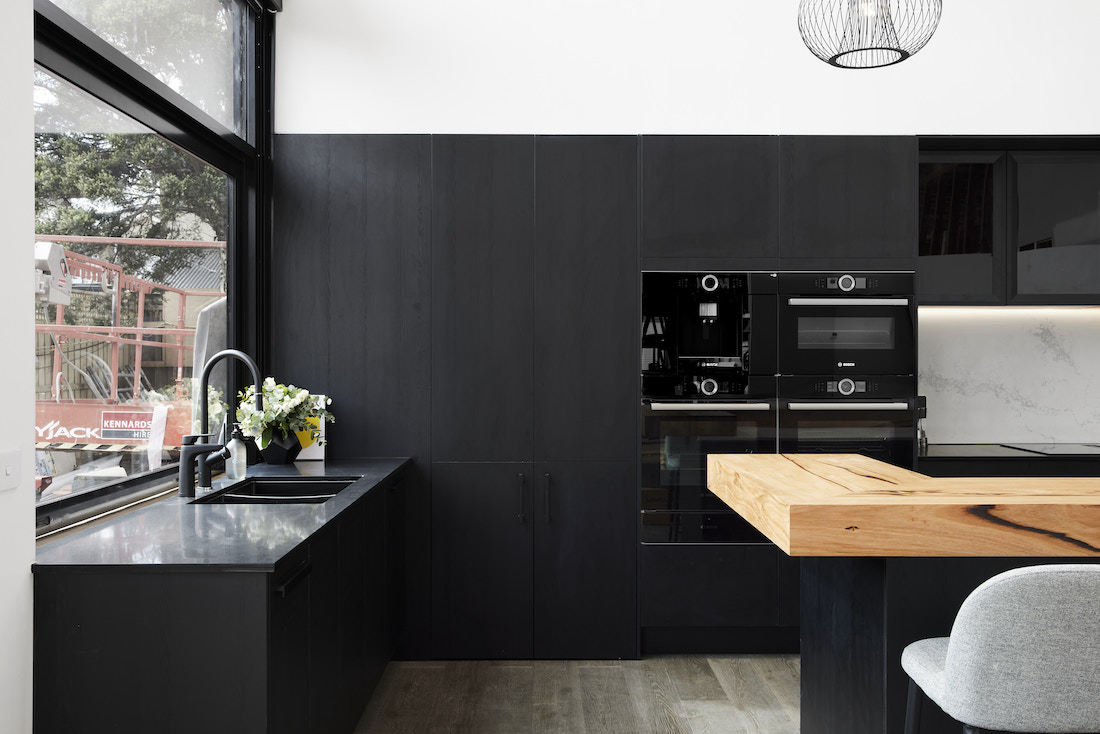 Black cabinetry in timber and back kitchen