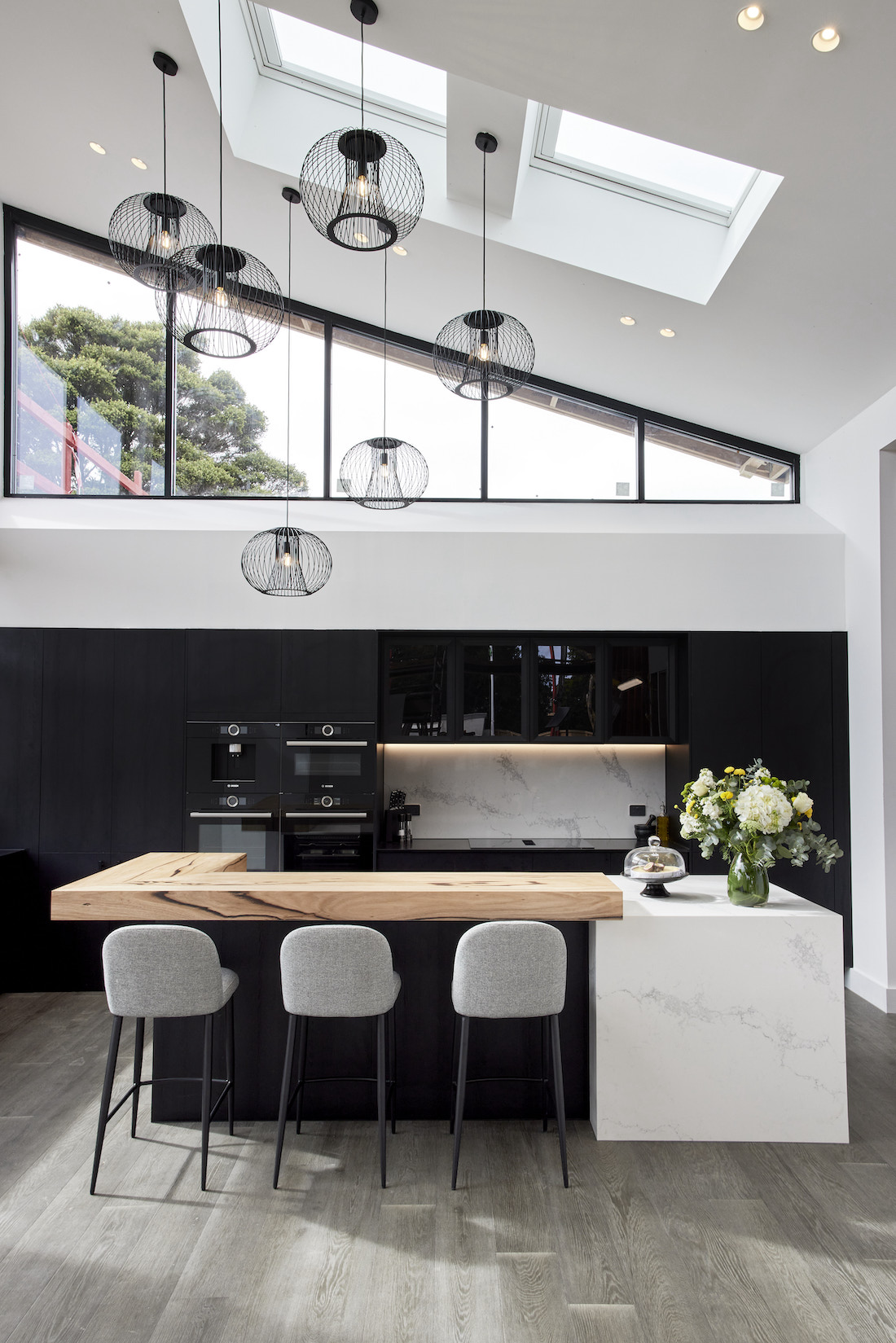 Triangle high window with black feature pendants