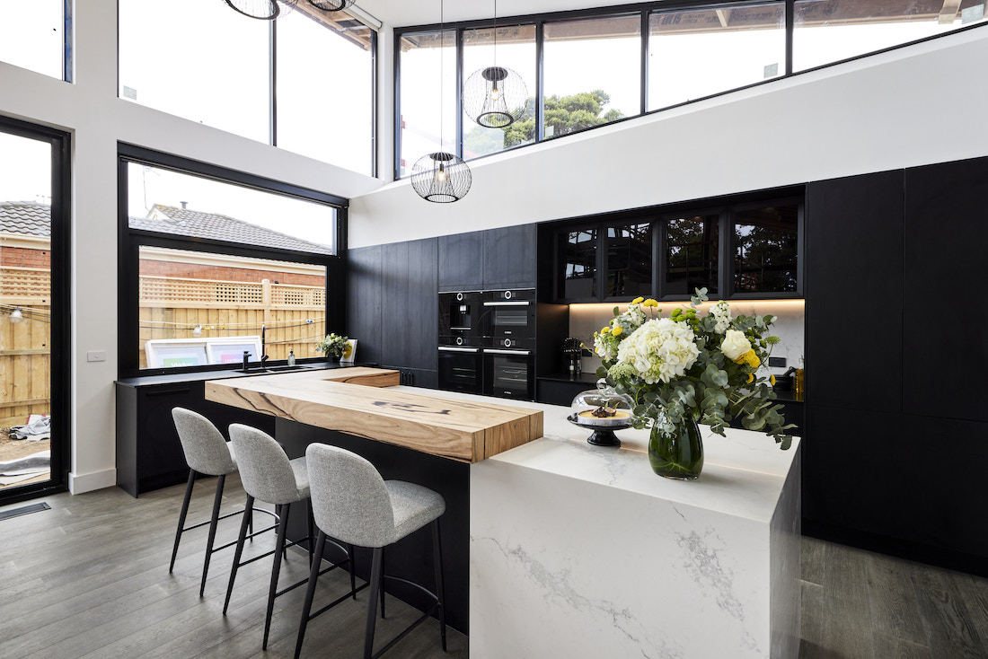 Stone benchtop with timber breakfast bar