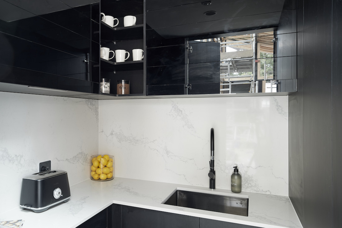 Butlers pantry with black cabinetry