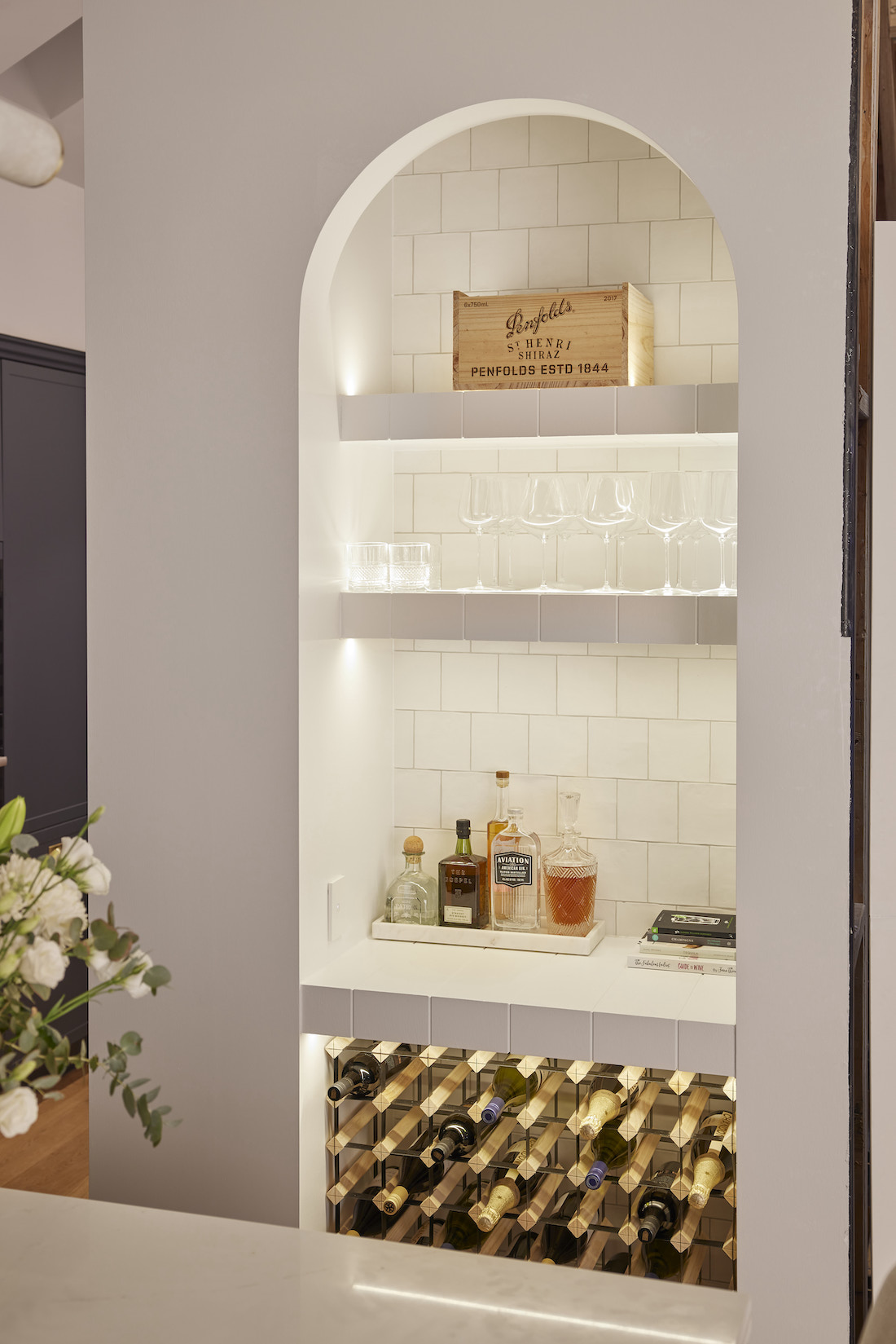 Arched recessed space in kitchen for bar