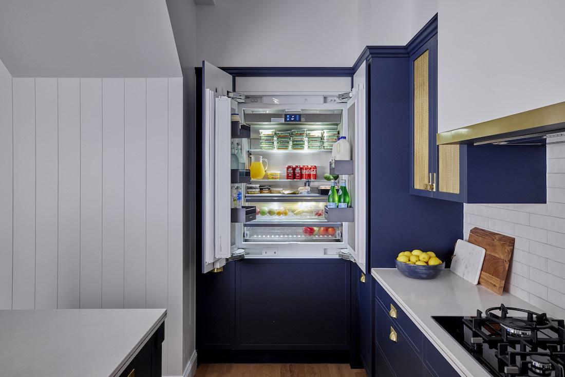 Integrated fridge in Hamptons kitchen