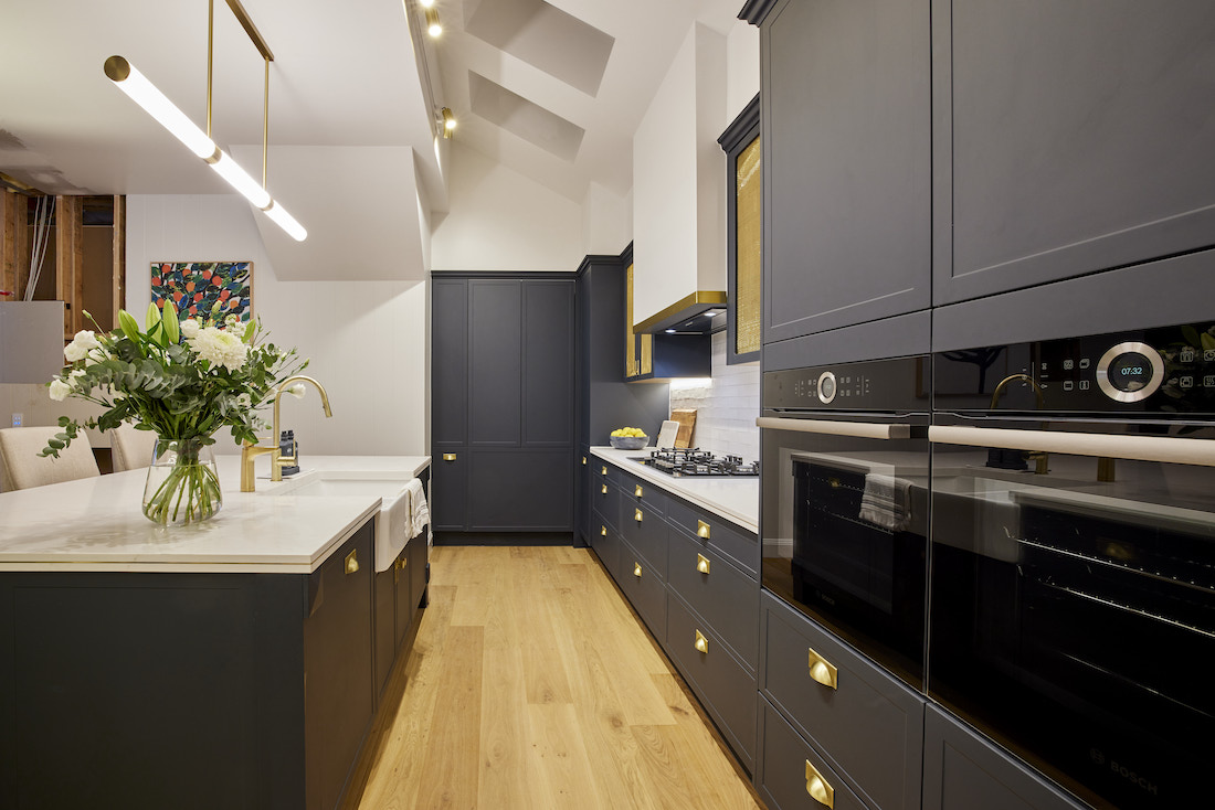 Navy and brass Hamptons style kitchen