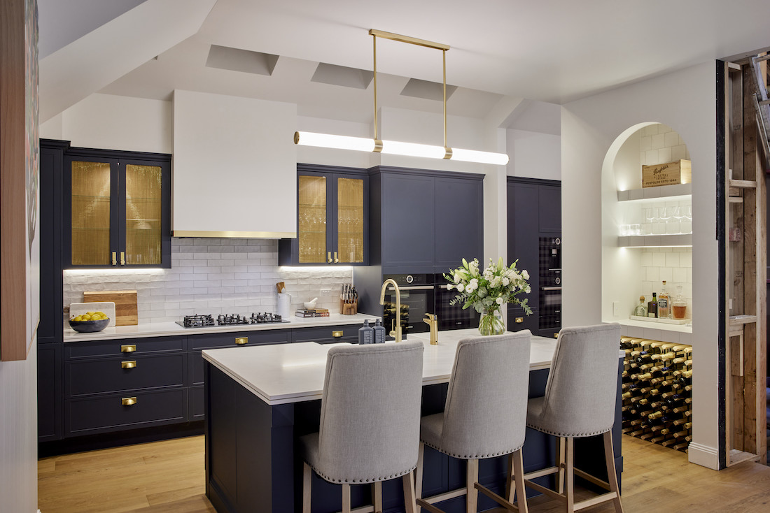 Navy and stone island bench in brass accented Hamptons kitchen