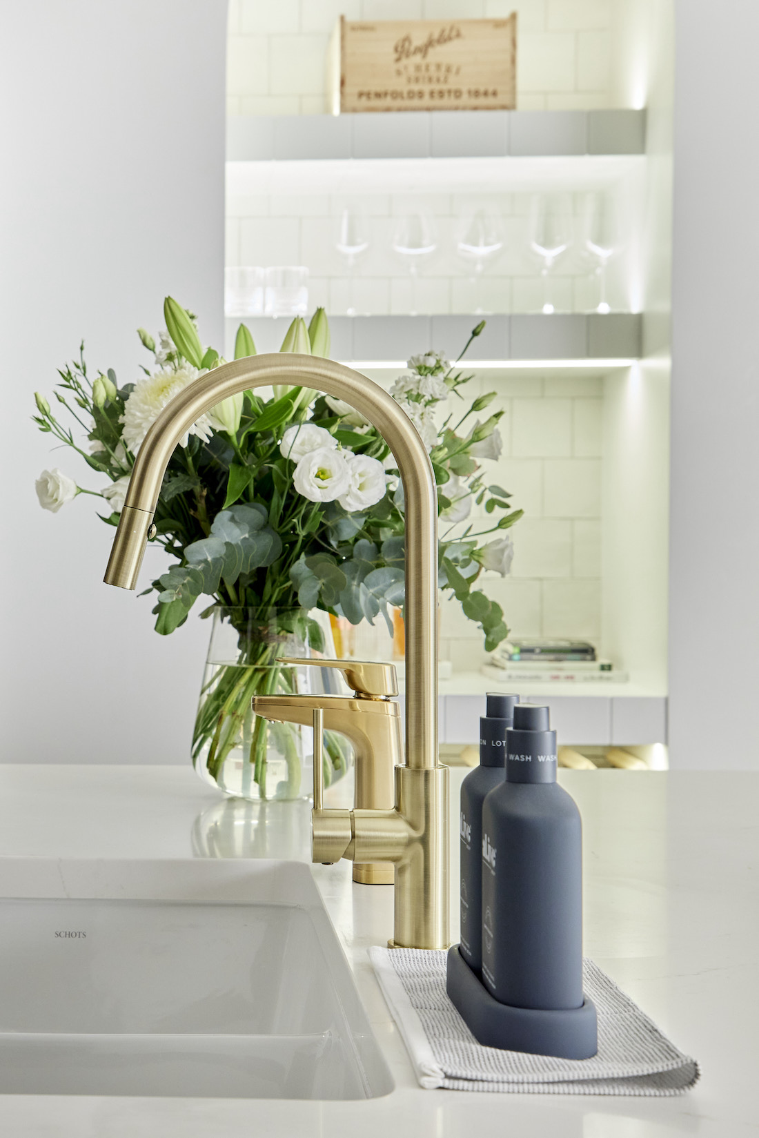 Gold gooseneck kitchen tap