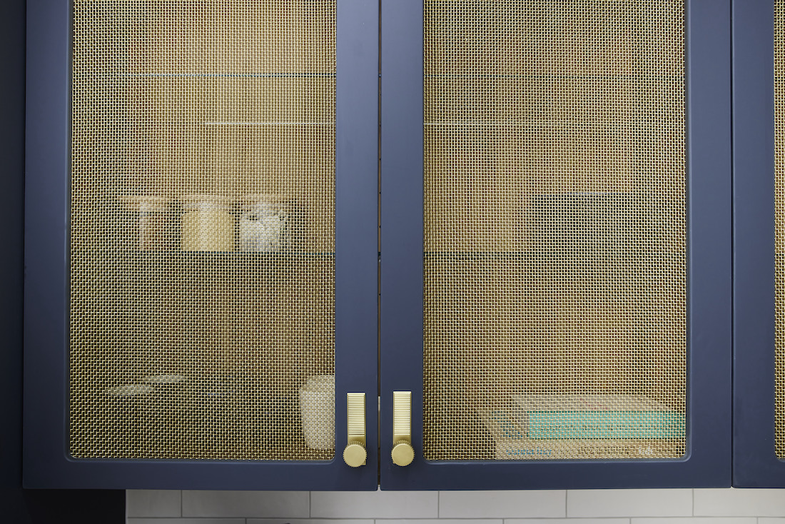 Brass inset navy cabinetry