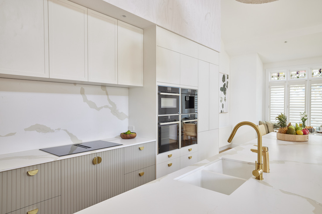 Textured cabinetry in white kitchen