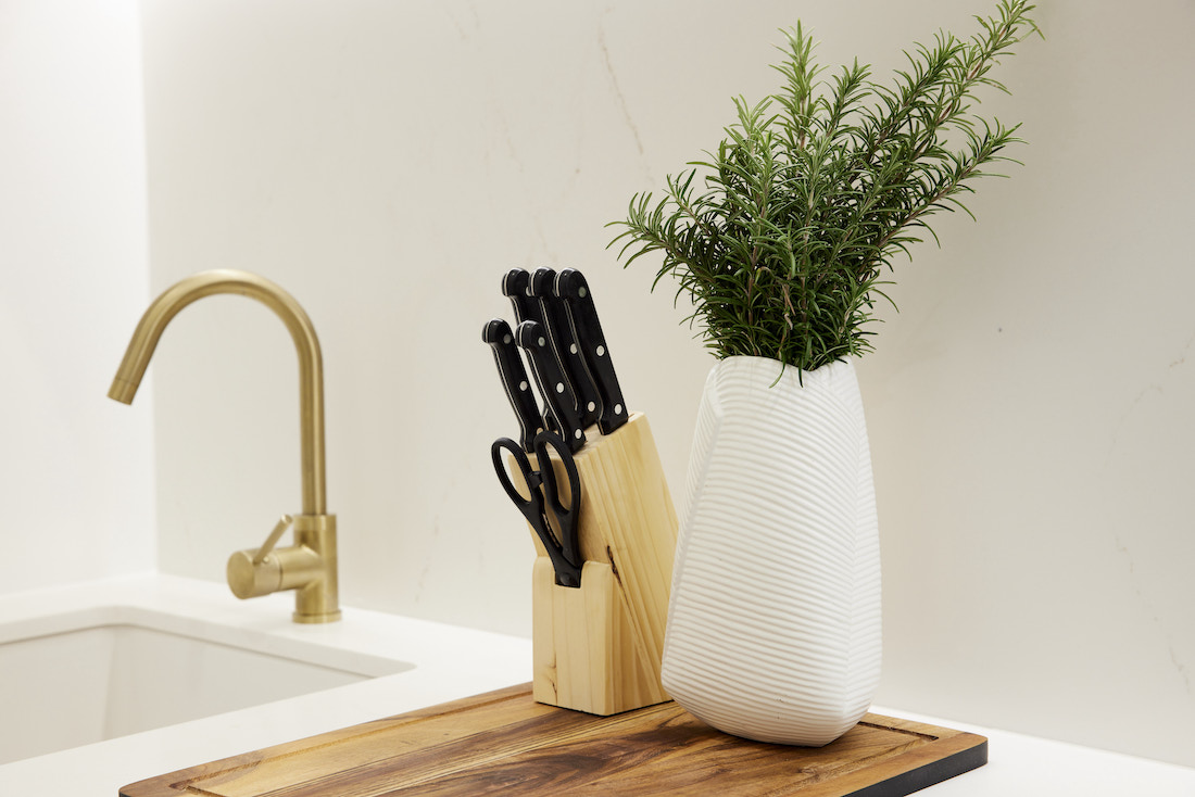 Kitchen vignette with knife block and gold tap