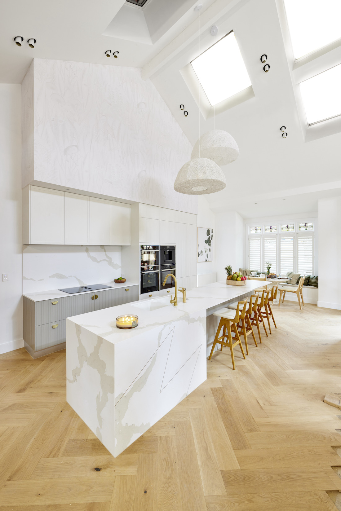 Marble benchtop in white and timber kitchen