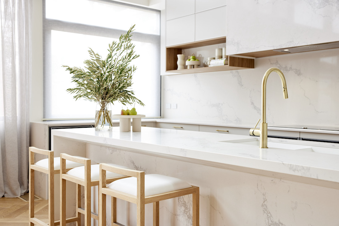 Stone benchtop with gold gooseneck tap