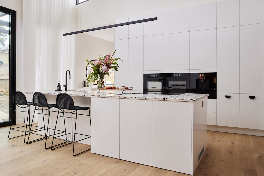 White and black kitchen with terrazzo benchtop