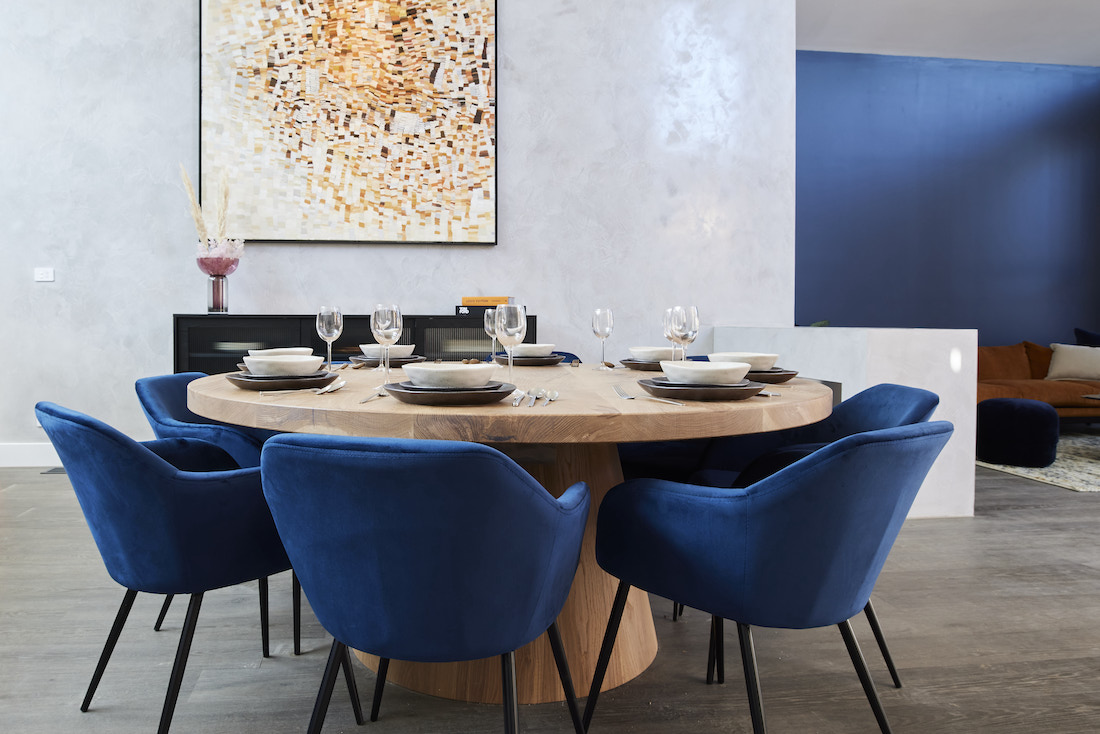 Christian Cole round dining table with blue velvet chairs