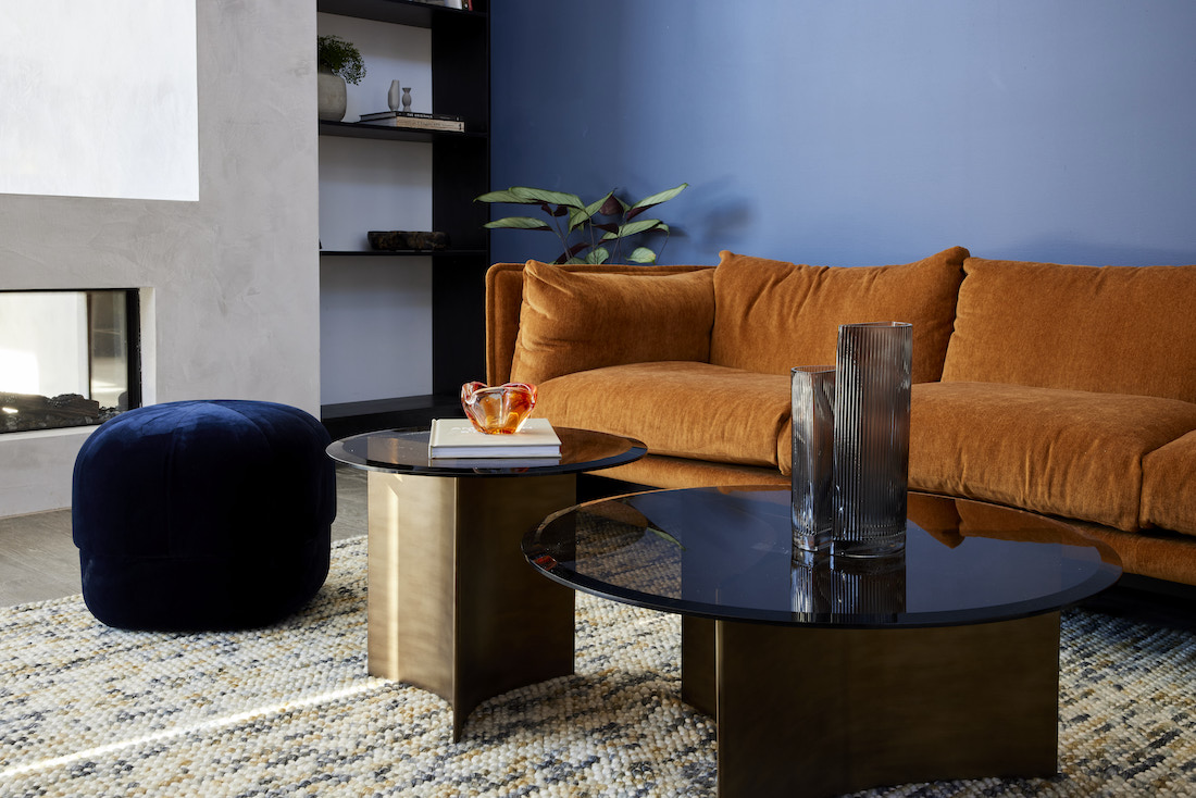 Tobacco coloured sofa with black and navy furnishings