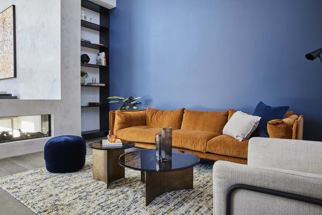 Blue wall with tobacco coloured sofa