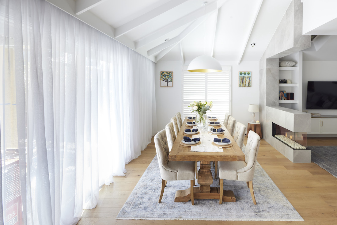Dining room with extra long table and raked ceiling