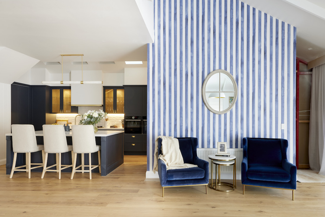 Blue striped feature wall seating nook by kitchen