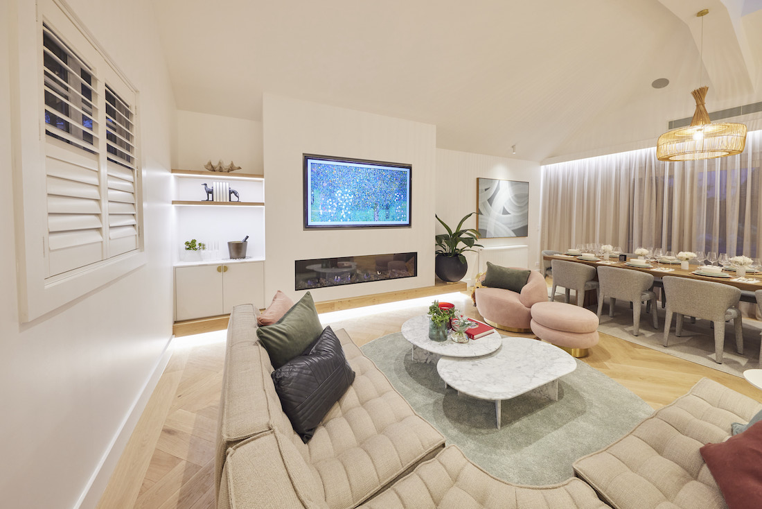 Living room with shelving space and dining room