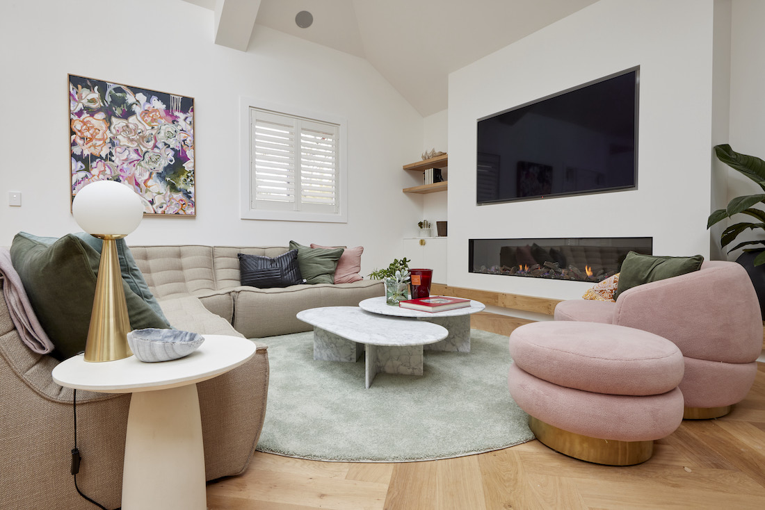 Round rug in living room with curved sofa