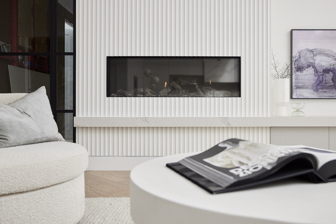 Scalloped wall with fireplace