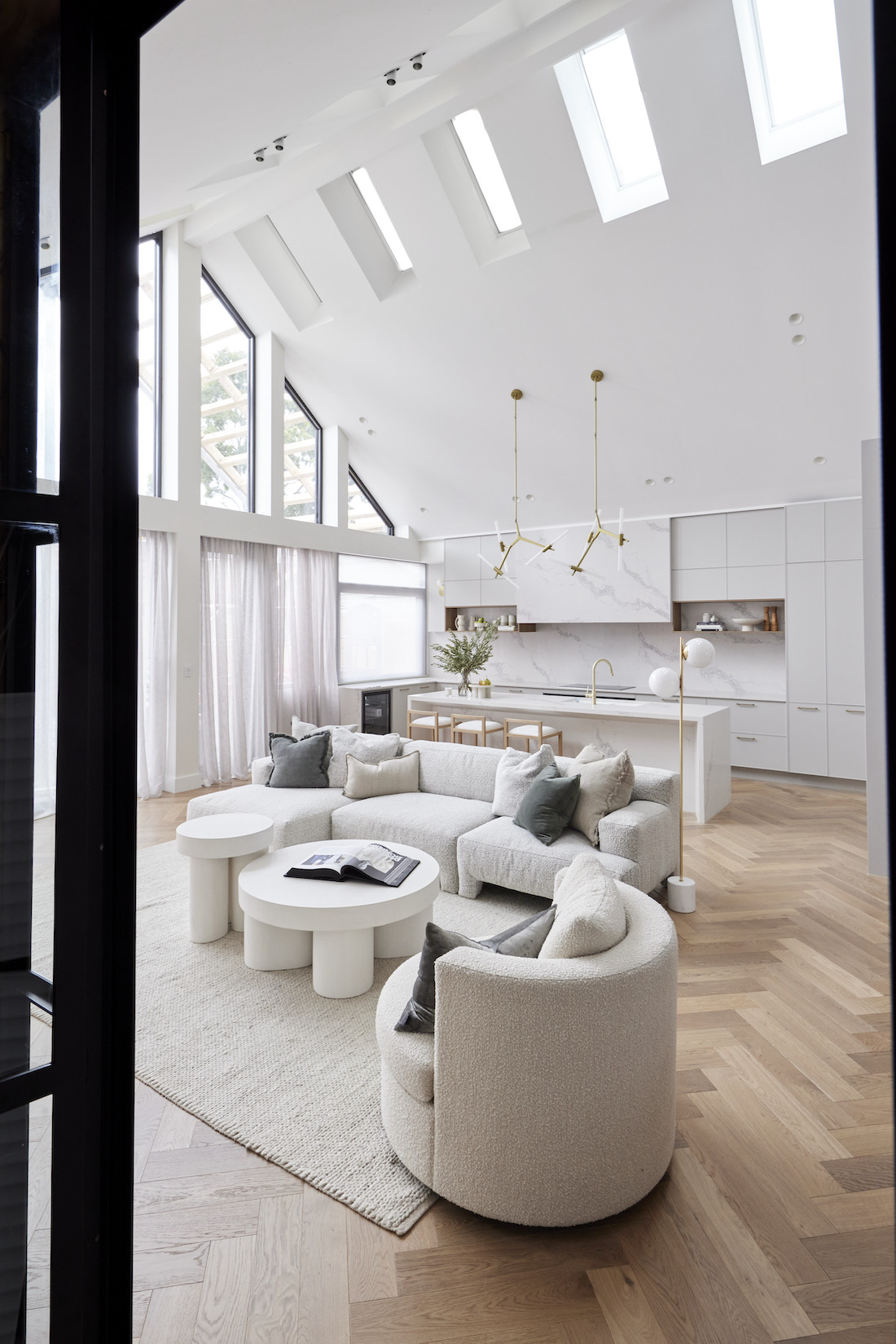Living space seating area with view to kitchen