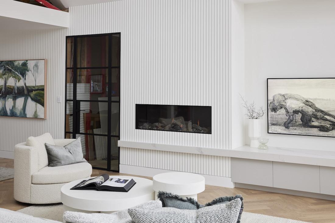 Scalloped wall detail around fireplace