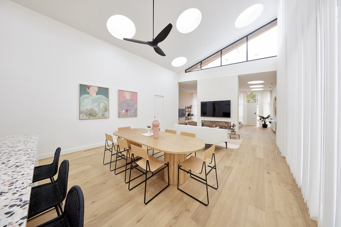 Round skylights over dining room with timber flooring