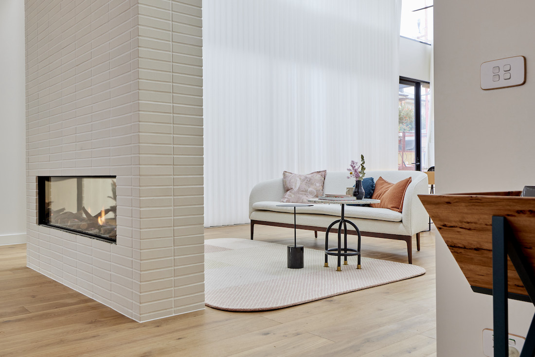 Double sided white brick fireplace