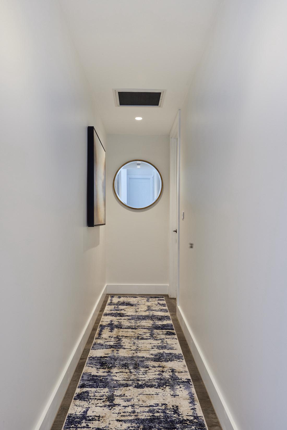 Hallway runner rug and round mirror